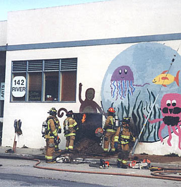 Firefighters cutting mural